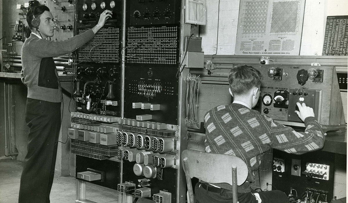 Electrical engineers using a telephone in 1939