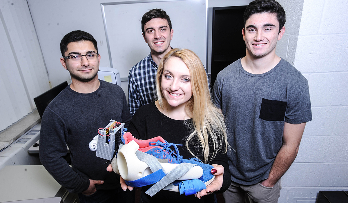 Students with a shoe project