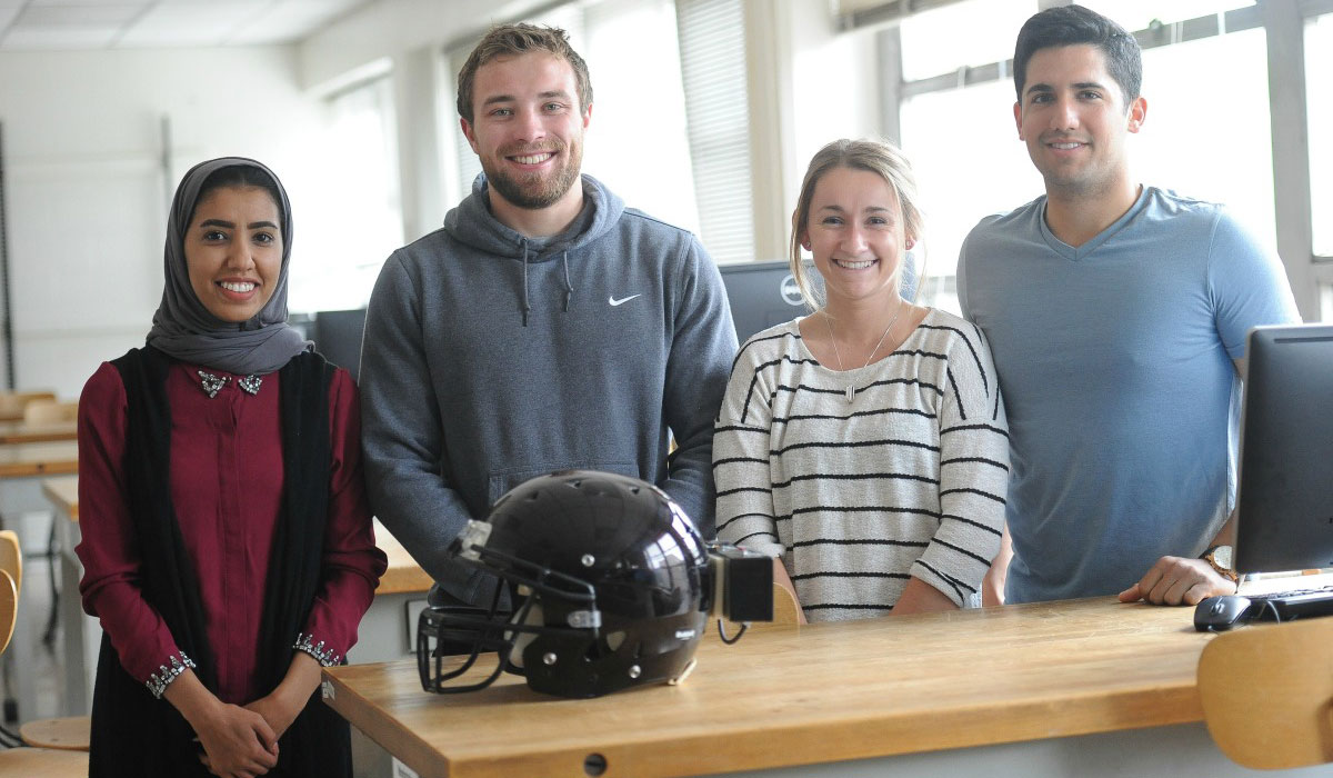 Students with a football helmet