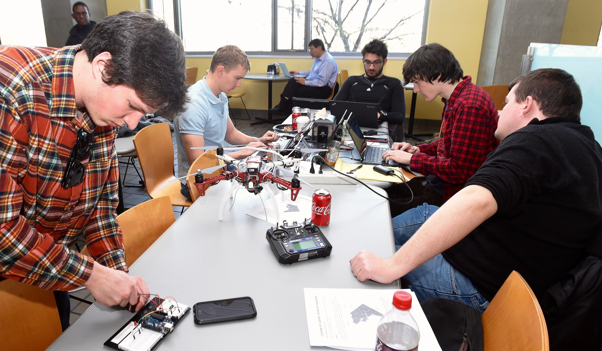 team of students programming a quadcopter